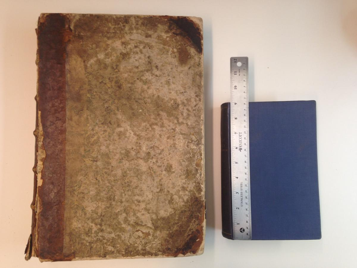 Left, the New York Society Library's Nuremberg Chronicle (1493), in a 19th century Library binding. Right, Sabin bibliography of American imprints in a 20th century buckram Library binding.