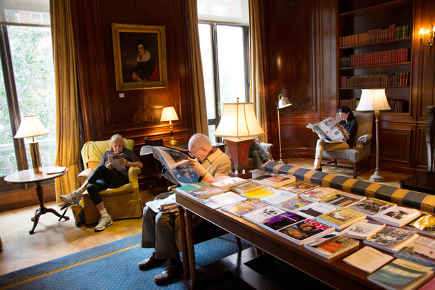 Library members reading periodicals in the Members' Room.
